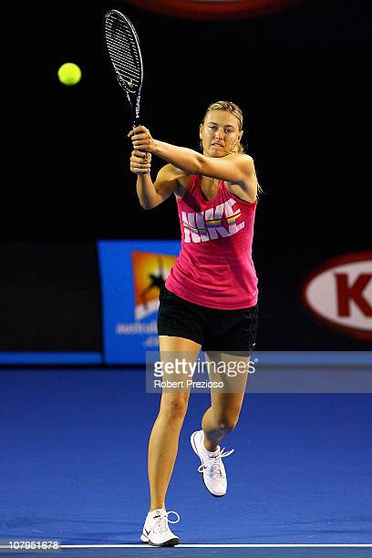 Maria Sharapova of Russia plays a backhand during a practice session ahead of the 2011 Australian Open at Melbourne Park on January 10 2011 in...