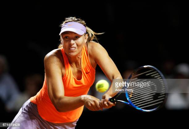 Maria Sharapova of Russia plays a backhand during her match against Anett Kontaveit of Estonia during the Porsche Tennis Grand Prix at Porsche Arena...