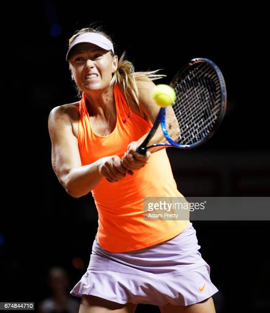 Maria Sharapova of Russia plays a backhand during her match against Kristina Mladenovic of France during the Porsche Tennis Grand Prix at Porsche...