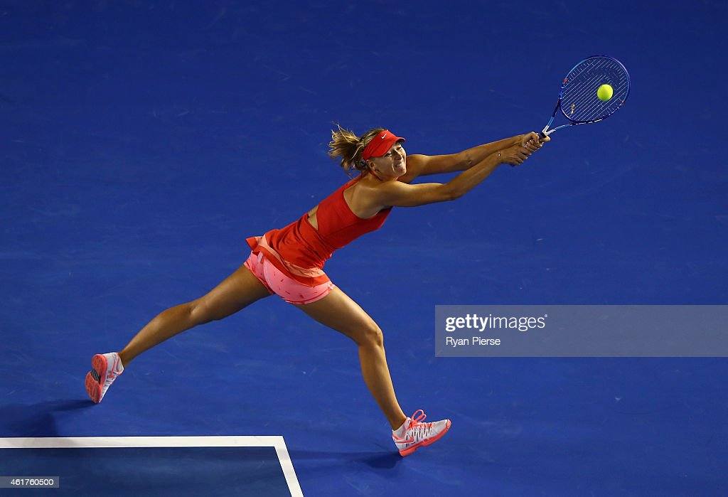 Maria Sharapova of Russia plays a backhand in her first round match against Petra Martic of Croatia during day one of the 2015 Australian Open at Melbourne Park on January 19, 2015 in Melbourne, Australia.