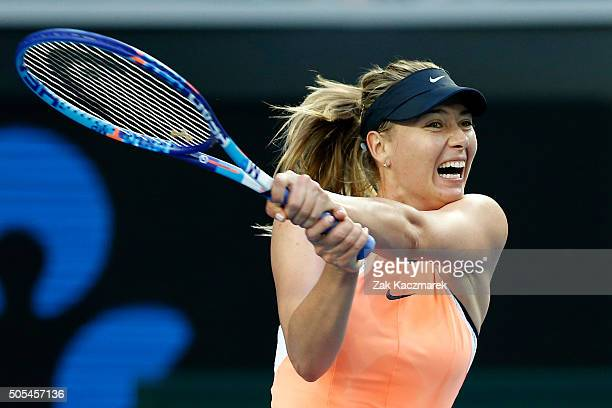Maria Sharapova of Russia plays a backhand in her first round match against Nao Hibino of Japan during day one of the 2016 Australian Open at...