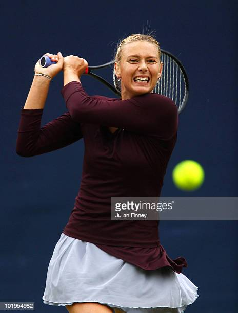 Maria Sharapova of Russia plays a backhand in her match against Alla Kudryavtseva of Russia during the AEGON Classic Tennis at the Edgbaston Priory...