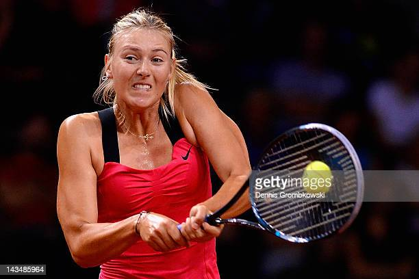 Maria Sharapova of Russia plays a backhand in her match against Samantha Stosur of Australia during day five of the WTA Porsche Tennis Grand Prix at...