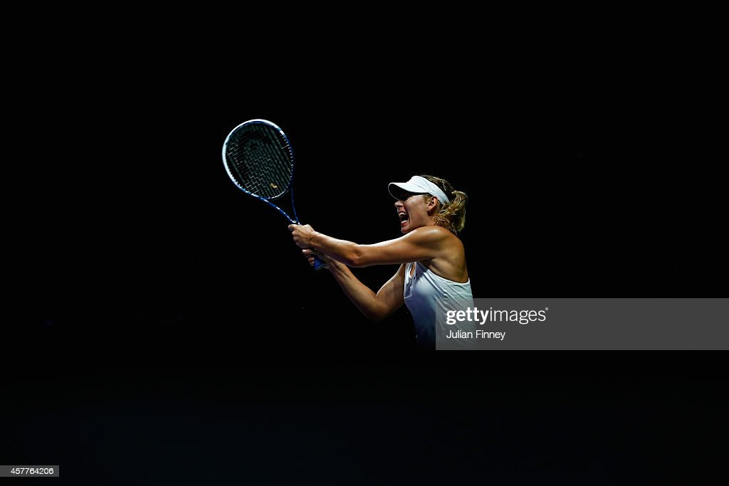 Maria Sharapova of Russia plays a backhand in her match against Agnieszka Radwanska of Poland during day five of the BNP Paribas WTA Finals tennis at the Singapore Sports Hub on October 24, 2014 in Singapore.