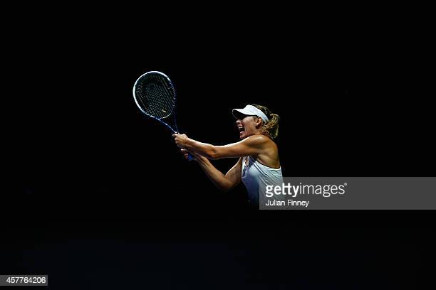 Maria Sharapova of Russia plays a backhand in her match against Agnieszka Radwanska of Poland during day five of the BNP Paribas WTA Finals tennis at...