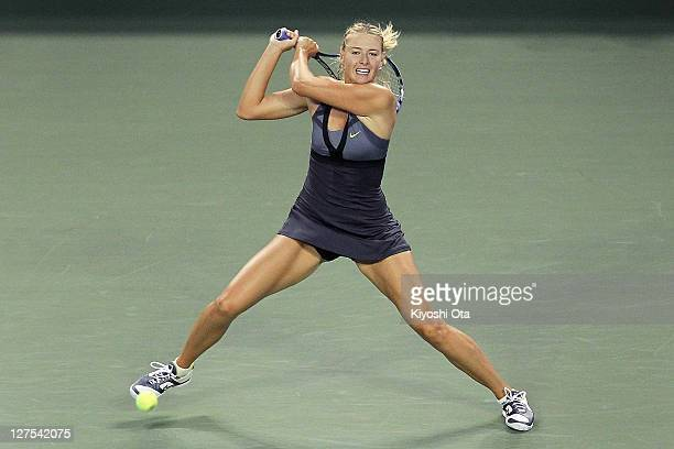 Maria Sharapova of Russia plays a backhand in her match against Petra Kvitova of the Czech Republic during the day five of the Toray Pan Pacific Open...