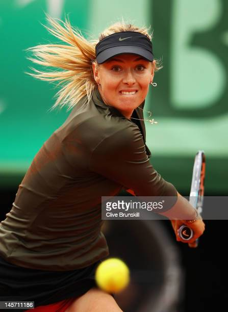 Maria Sharapova of Russia plays a backhand in her women's singles fourth round match against Klara Zakopalova of Czech Republic during day 9 of the...
