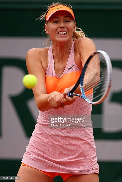 Maria Sharapova of Russia plays a backhand in her women's singles match against Samantha Stosur of Australia on day eight of the French Open at...