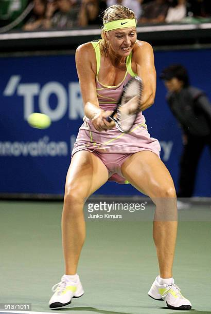 Maria Sharapova of Russia plays a backhand in the women's final match against Jelena Jankovic of Serbia during day seven of the Toray Pan Pacific...