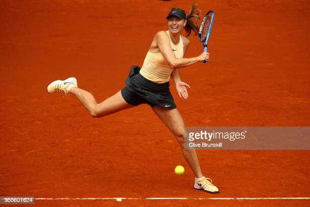 Maria Sharapova of Russia plays a forehand against IrinaCamelia Begu of Romania in their second round match during day three of the Mutua Madrid Open...
