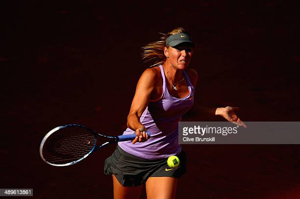 Maria Sharapova of Russia plays a forehand against Simona Halep of Romania in their final match during day nine of the Mutua Madrid Open tennis...