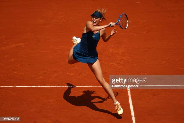 Maria Sharapova of Russia plays a forehand during her ladies singles third round match against Kristyna Pliskova of Czech Republic during day seven...