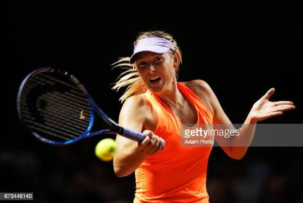 Maria Sharapova of Russia plays a forehand during her match against Roberta Vinci of Italy during the Porsche Tennis Grand Prix at Porsche Arena on...