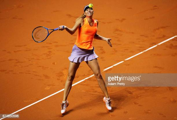 Maria Sharapova of Russia plays a forehand during her match against Kristina Mladenovic of France during the Porsche Tennis Grand Prix at Porsche...