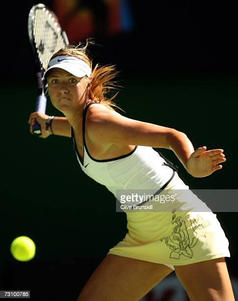 Maria Sharapova of Russia plays a forehand during her semi-final match against Kim Clijsters of Belgium on day eleven of the Australian Open 2007 at...