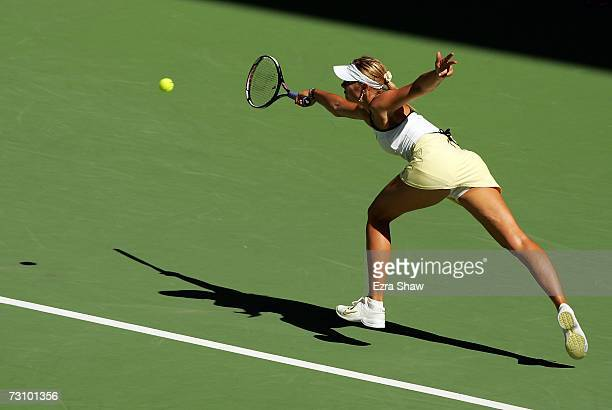 Maria Sharapova of Russia plays a forehand during her semifinal match against Kim Clijsters of Belgium on day eleven of the Australian Open 2007 at...