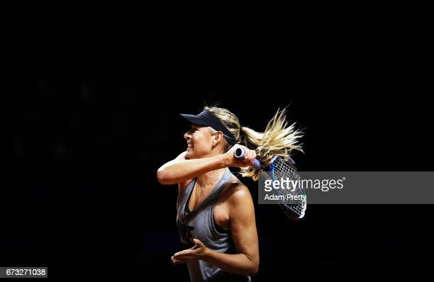 Maria Sharapova of Russia plays a forehand during training before her match against Roberta Vinci of Italy during the Porsche Tennis Grand Prix at...