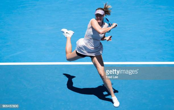 Maria Sharapova of Russia plays a forehand in her first round match against Tatjana Maria of Germany on day two of the 2018 Australian Open at...