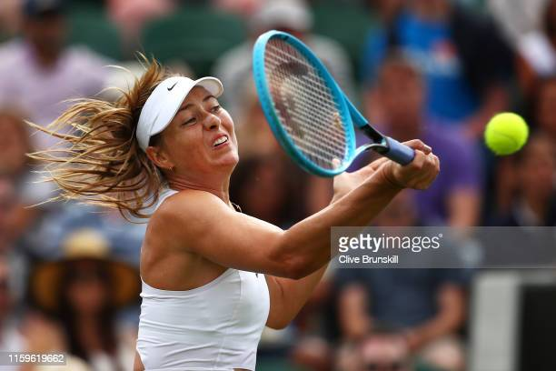 Maria Sharapova of Russia plays a forehand in her Ladies' Singles first round match against Pauline Parmentier of France during Day two of The...