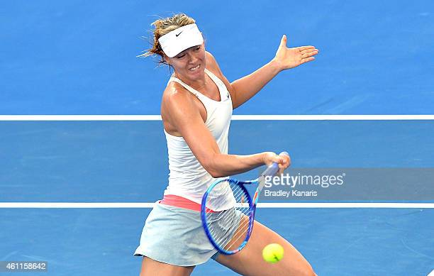 Maria Sharapova of Russia plays a forehand in her match against Carla Suarez Navarro of Spain during day five of the 2015 Brisbane International at...