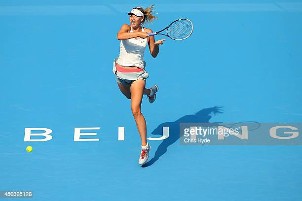 Maria Sharapova of Russia plays a forehand in her match against Elina Scitolina of Ukraine during day four of of the China Open at the National...