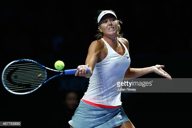 Maria Sharapova of Russia plays a forehand in her match against Agnieszka Radwanska of Poland during day five of the BNP Paribas WTA Finals tennis at...