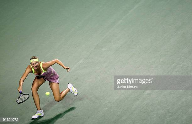 Maria Sharapova of Russia plays a forehand in her match against Agnieszka Radwanska of Poland during day six of the Toray Pan Pacific Open Tennis...