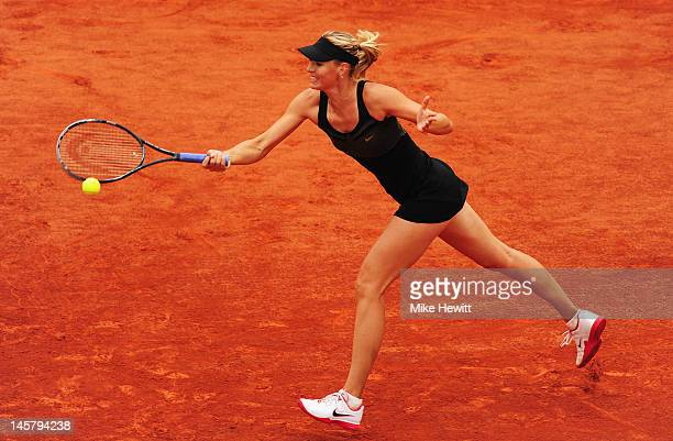 Maria Sharapova of Russia plays a forehand in her women's singles quarter final match against Kaia Kanepi of Estonia during day 11 of the French Open...