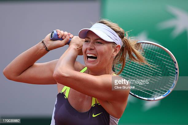 Maria Sharapova of Russia plays a forehand in her womens' singles semifinal match against Victoria Azarenka of Belarus against during day twelve of...