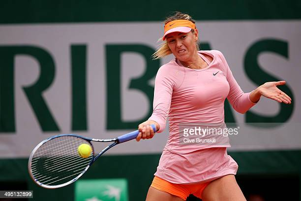 Maria Sharapova of Russia plays a forehand in her women's singles match against Samantha Stosur of Australia on day eight of the French Open at...