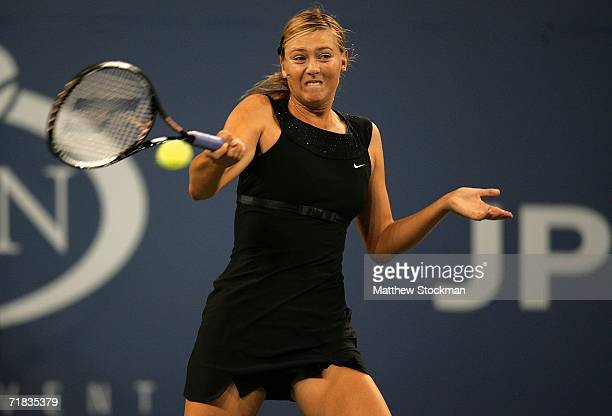 Maria Sharapova of Russia plays a forehand to Justine Henin-Hardenne of Belgium during the women's final at the U.S. Open at the USTA Billie Jean...