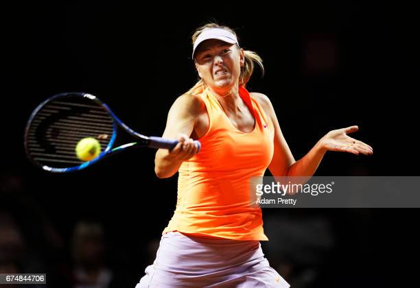 Maria Sharapova of Russia plays a forehand uring her match against Kristina Mladenovic of France during the Porsche Tennis Grand Prix at Porsche...