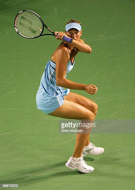 Maria Sharapova of Russia plays a lefthanded shot in her semifinal match against Justine HeninHardenne of Belgium during day eleven of the Australian...