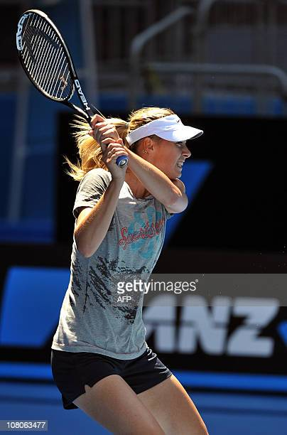 Maria Sharapova of Russia plays a shot during a practice session in Melbourne on January 16 ahead of the Australian Open tennis tournament Russian...