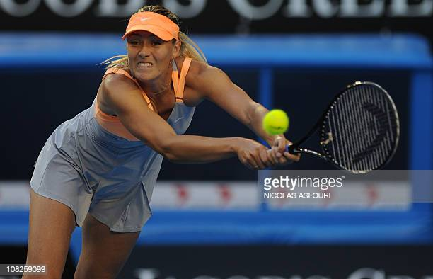 Maria Sharapova of Russia plays a stroke during her fourth round women's singles match against Andrea Petkovic of Germany on the seventh day of the...