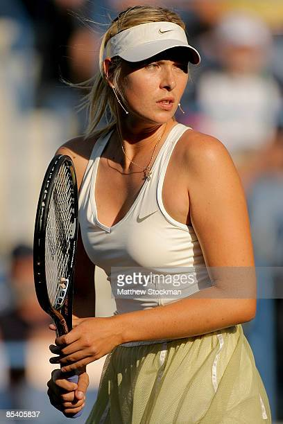 Maria Sharapova of Russia plays doubles with Elena Vesnina of Russia during the BNP Paribas Open at the Indian Wells Tennis Garden March 12 2009 in...