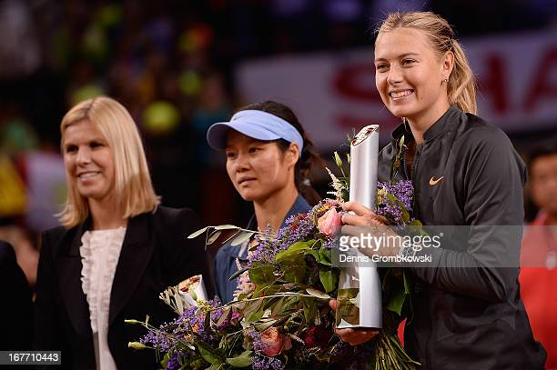 Maria Sharapova of Russia poses with her trophy after winning her final match against Na Li of China during Day 7 of the Porsche Tennis Grand Prix at...