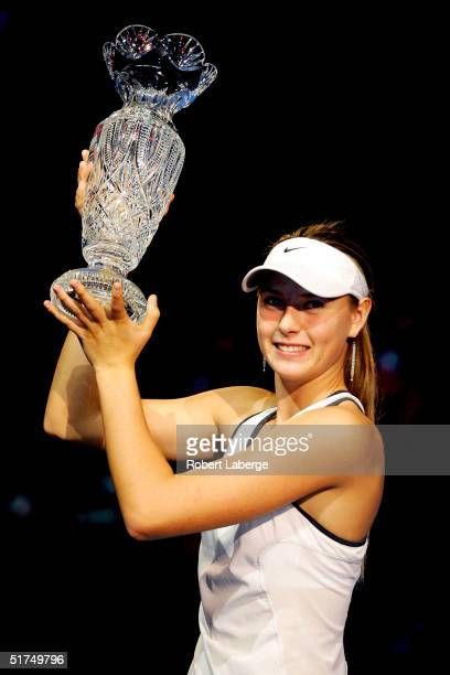 Maria Sharapova of Russia poses with the championship trophy after defeating Serena Williams in the finals of the WTA Tour Championship Tournament at...