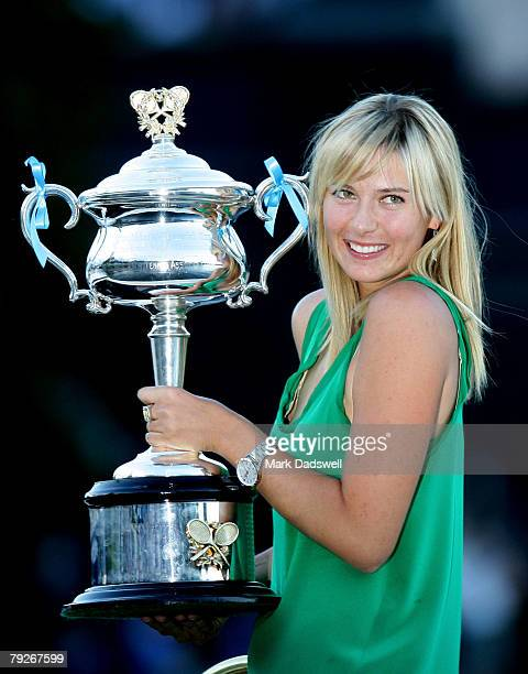 Maria Sharapova of Russia poses with the Daphne Akhurst Memorial Cup on a boat along the Yarra River after her victory in the women's final match...