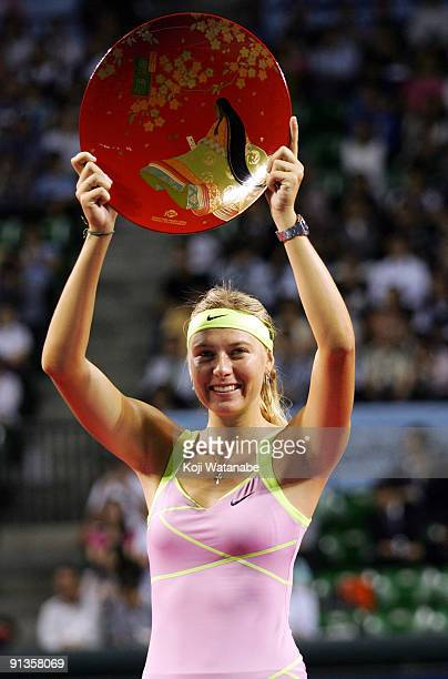 Maria Sharapova of Russia poses with the trophy after winning the women's final match against Jelena Jankovic of Serbia during day seven of the Toray...