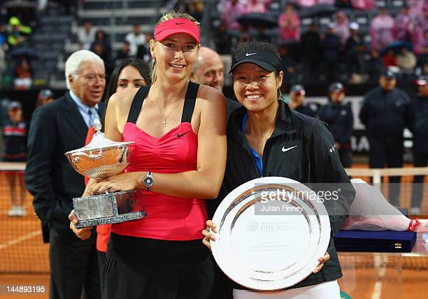 Maria Sharapova of Russia poses with the winners trophy with runner up Na Li of China during their final match during day nine of the Internazionali...