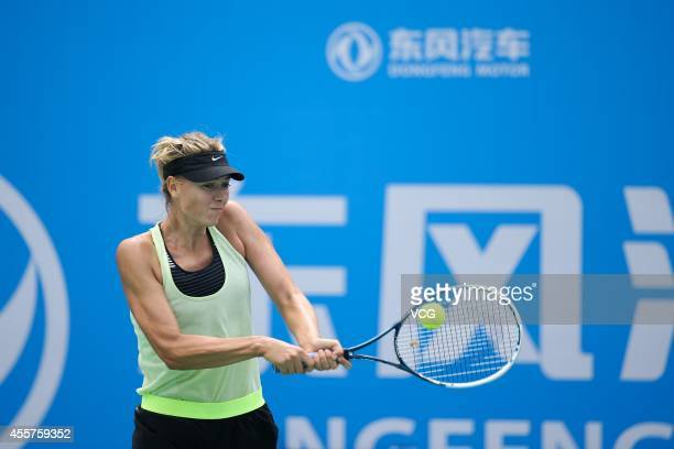 Maria Sharapova of Russia practices ahead of the start of 2014 WTA Wuhan Open at Optical Valley International Tennis Center on September 20 2014 in...