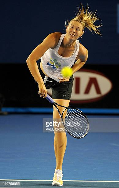 Maria Sharapova of Russia practices her serve during a training session for the upcoming Australian Open tennis tournament in Melbourne on January 13...