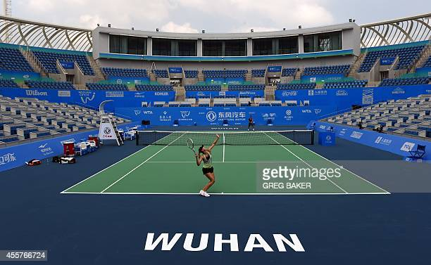 Maria Sharapova of Russia practices on center court at the Optics Valley International Tennis Center ahead of the start of the Wuhan Open tennis...