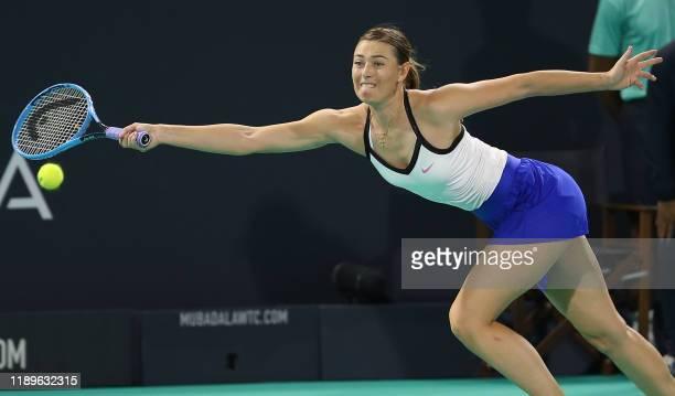 TOPSHOT Maria Sharapova of Russia reaches to return the ball to Ajla Tomljanovic of Australia during the Mubadala World Tennis Championship at Zayed...