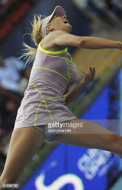 Maria Sharapova of Russia reacts after beating Victoria Azarenka of Belarus during the second round match at the China Open 2009 in Beijing on...