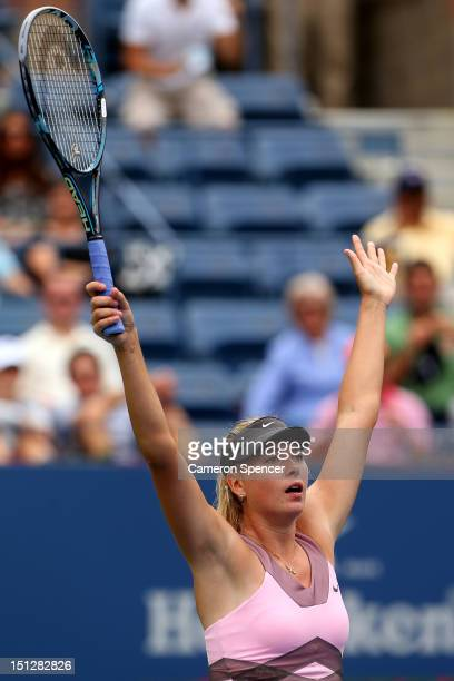 Maria Sharapova of Russia reacts after defeating Marion Bartoli of France in their women's singles quarterfinal match on Day Ten of the 2012 US Open...