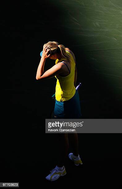 Maria Sharapova of Russia reacts after losing a point against Jie Zheng of China on March 14 2010 in Indian Wells California