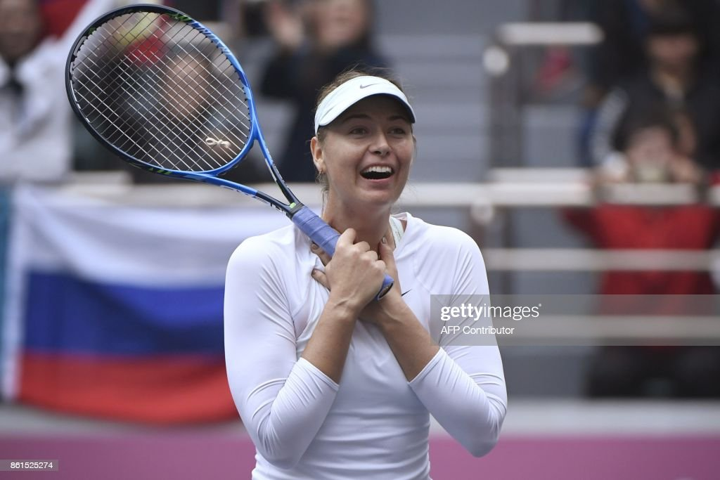 Maria Sharapova of Russia reacts after winning her women's singles final match against Aryna Sabalenka of Belarus at the Tianjin Open tennis tournament in Tianjin on October 15, 2017. / AFP PHOTO / WANG Zhao