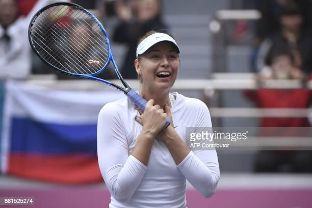 Maria Sharapova of Russia reacts after winning her women's singles final match against Aryna Sabalenka of Belarus at the Tianjin Open tennis...